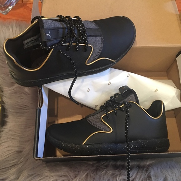 sale retailer 136b1 9058c Jordans black and gold size 4.5 youth women 6